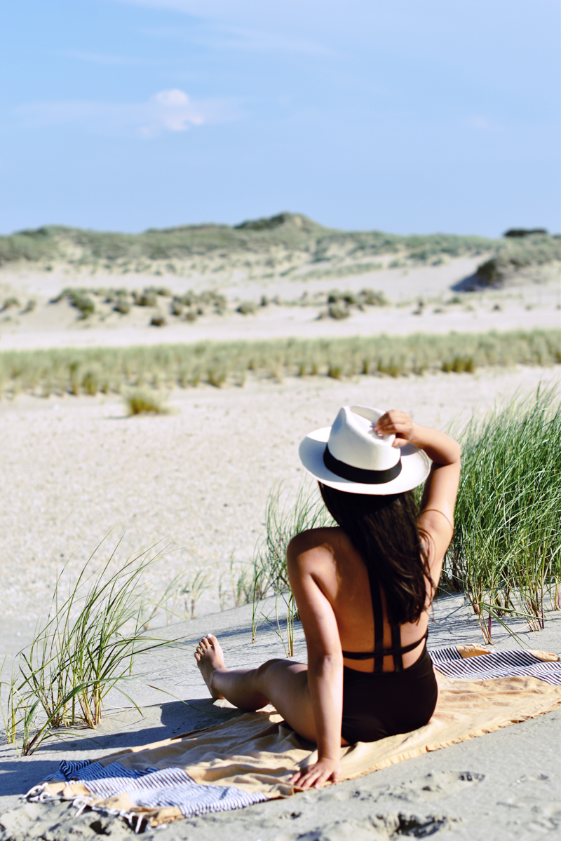 irenevanguin-bathing-suit-panama-hat-beach-black-urban-outfitters-cutout