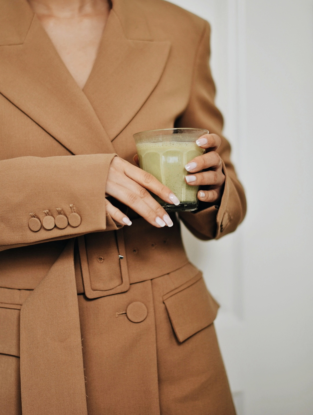 office attire camel blazer and matcha latte